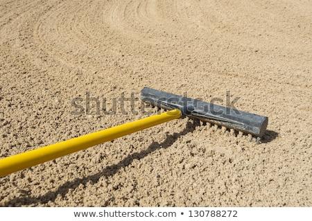 Sand trap rake in a bunker Stock photo © njnightsky