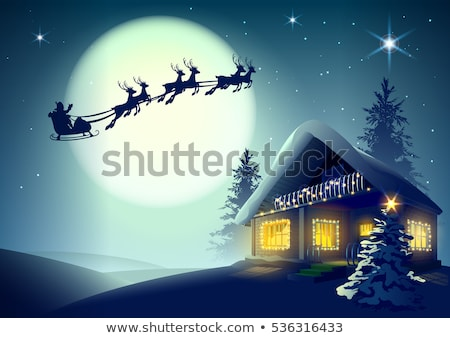 Сток-фото: Silhouette Santa Claus And Reindeer Flying Over Christmas House In Winter Forest