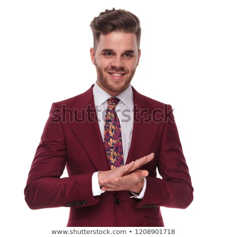 elegant man rubbing his palms and looks to side Stock photo © feedough