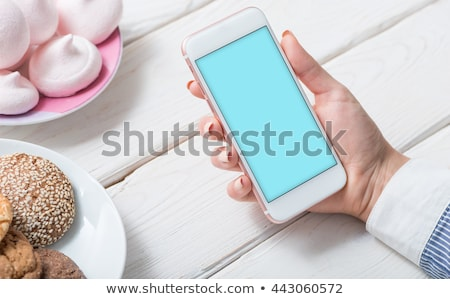 White isolated screen smartphone mock-up on black wooden table Stock photo © manera