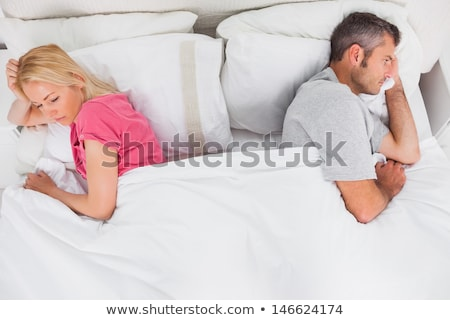 Couple lying in bed back to back looking unhappy Stock photo © monkey_business