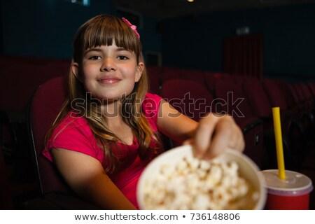 портрет девушки попкорн контейнера сидят Сток-фото © wavebreak_media