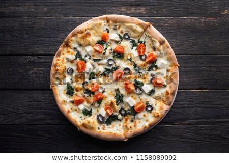 Calabresa azeitonas pretas pizza metade Foto stock © zhekos