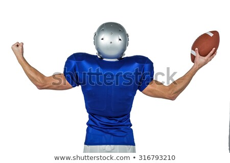 american football player flexing muscles while holding ball stock photo © wavebreak_media