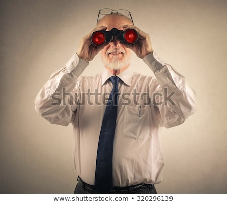 bingo businessman looking through binoculars stock photo © studiostoks