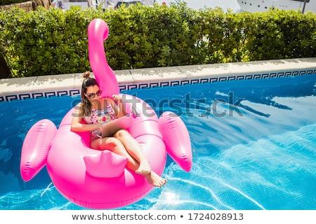 Genç kadın bikini bahçe okuma kadın kitap Stok fotoğraf © IS2