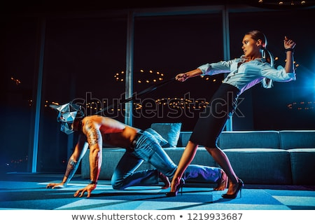 Couple role playing with dog leash Stock photo © monkey_business