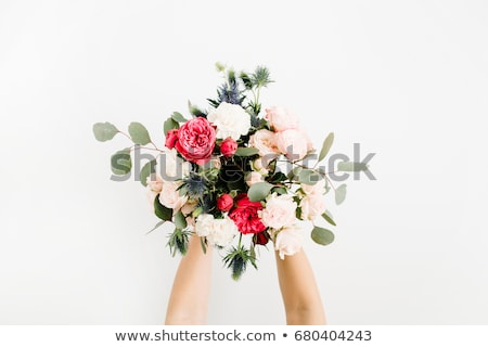woman holding bouquet of flowers Stock photo © LightFieldStudios