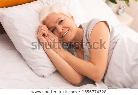 nő · ágy · mosolygó · nő · mosolyog · szexi · női - stock fotó © monkey_business