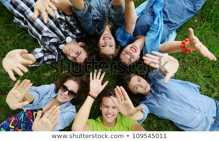 young people lying in field Stock photo © IS2