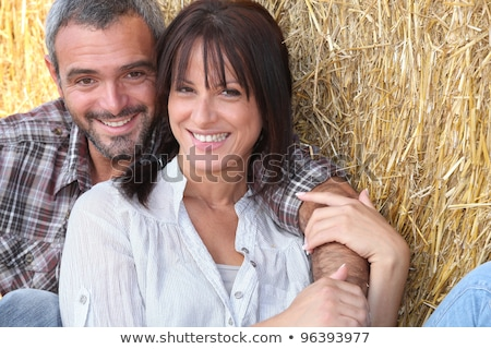 woman sitting on hay bale Stock photo © IS2