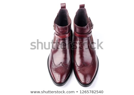 Pair of red high-heel shoes on the deep red background Stock photo © majdansky
