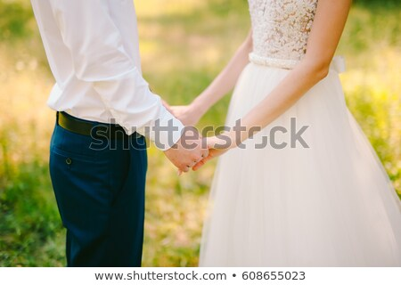 Newlyweds holding vintage picture frame Stock photo © IS2