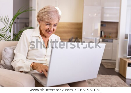 Senior woman Using Computer Stock photo © FreeProd