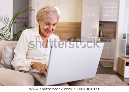 старший · женщину · используя · ноутбук · компьютер · домой - Сток-фото © freeprod