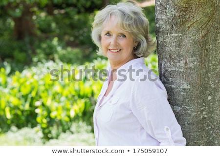 Portré mosolyog idős nő dől fa Stock fotó © FreeProd