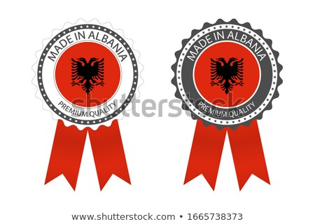 modern vector made in albania label isolated on white background simple sticker with albanian color stock photo © kurkalukas