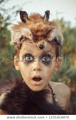 Surprised funny caveman boy portrait. Stock photo © artfotodima