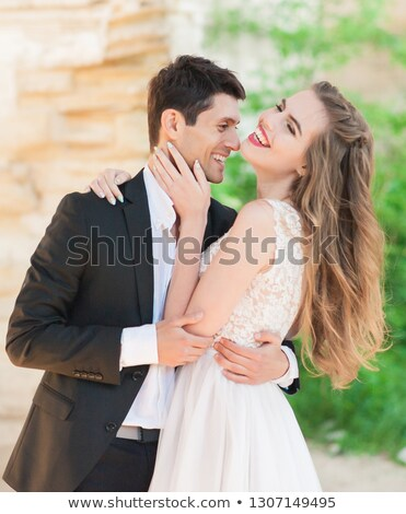 Stock photo: Bride and groom embrace each other