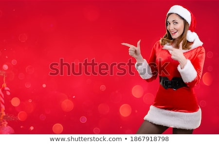 Portrait of a cheerful girl dressed in sweater and scarf Stock photo © deandrobot