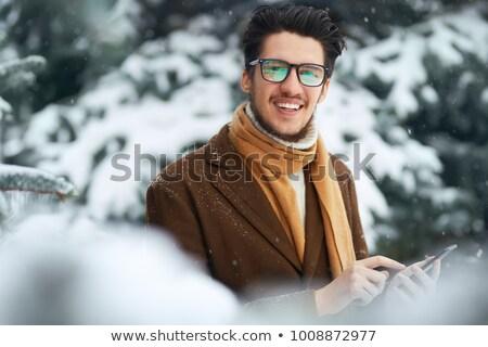 Bello giovane maglione sciarpa bere Foto d'archivio © deandrobot