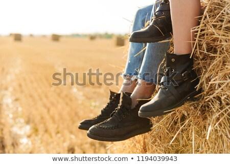 Fotó fiatalember nő ül nagy szénaboglya Stock fotó © deandrobot