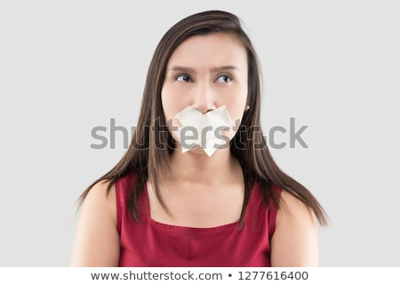 Thai female in with adhesive tape over his mouth Stock photo © eddows_arunothai