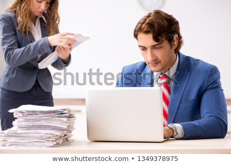 Deaf employee using hearing aid in office Stock photo © Elnur