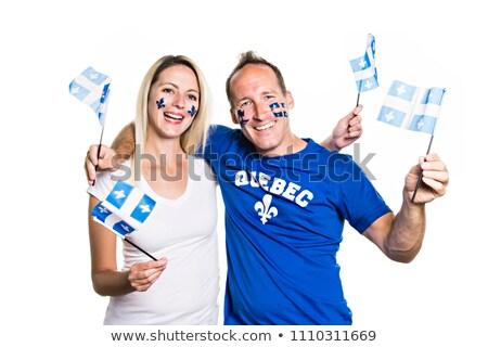 Foto stock: Couple Celebrates The National Holiday In Studio White Background