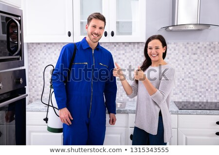 Smiling Woman Showing Thumbs Up Sign With Pest Control Worker Stock photo © AndreyPopov