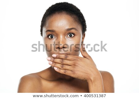 Hush be quiet woman isolated on black. Beautiful girl with finger on her lips. Stock photo © artfotodima