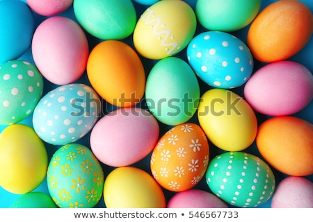 Easter egg and blue spring flowers Stock photo © Artspace