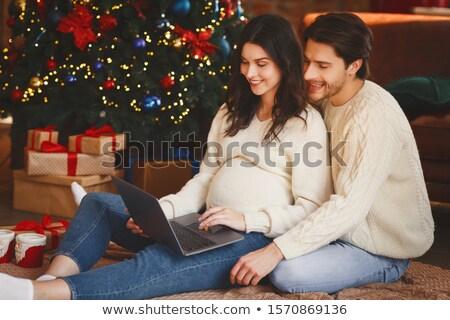 człowiek · ciąży · żona · zakupy · online · christmas - zdjęcia stock © dolgachov