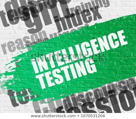 Intelligence Test on White Brickwall. Wordcloud Concept. Foto stock © tashatuvango