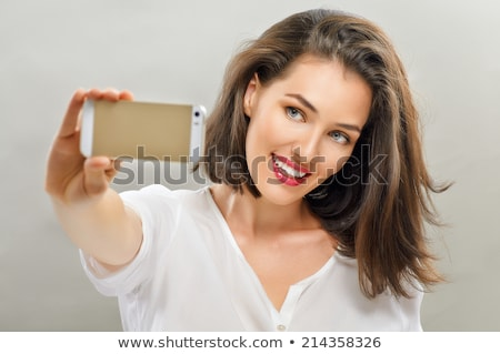 young woman taking selfie on mobile phone stock photo © andreypopov