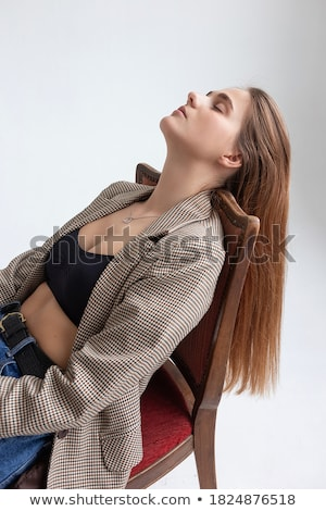 attractive young blue eyed woman lying on her back stock photo © giulio_fornasar