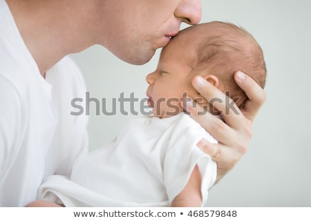 close up of father with little baby girl at home stock photo © dolgachov