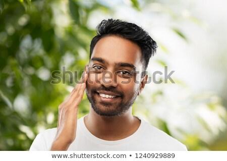 Indiano homem tocante barba pessoas azul Foto stock © dolgachov
