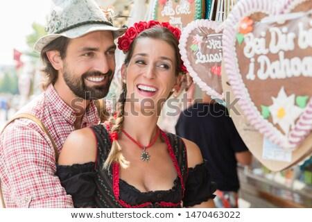 Couple buying gingerbread hearts of Bavarian fair Stock photo © Kzenon