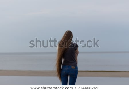 Fiatal tinilány áll tengerpart nő víz Stock fotó © Lopolo