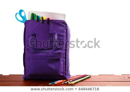 Abrir roxo mochila material escolar mesa de madeira de volta à escola Foto stock © Illia