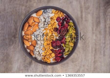 Mango tazón almendra dragón frutas secado Foto stock © galitskaya