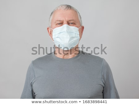 Man wearing protective Medical mask for prevent virus Novel Coronavirus 2019-nCoV and air pollution. Stock photo © ikopylov