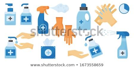 bottle with antibacterial gel in the hands in protective gloves Stock photo © laciatek