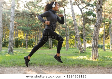 Image of african american sportswoman running while working out Stock photo © deandrobot