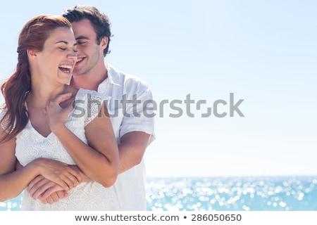 Boldog pár ölel nyár tengerpart ünnepek Stock fotó © dolgachov