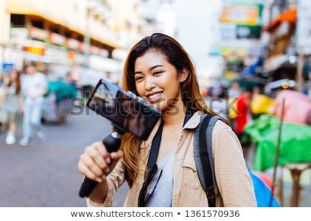 Asian vrouwelijke blogger video bloggen Stockfoto © dolgachov