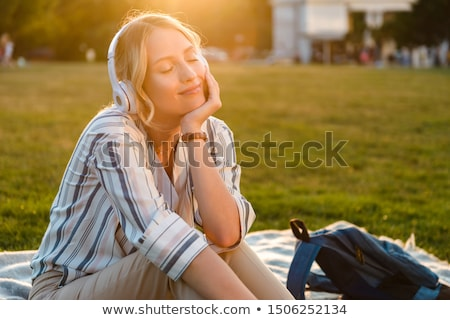Cute woman relaxing on nature stock photo © fotografci