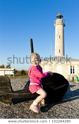 sitting little girl richard lighthouse aquitaine france stock photo © phbcz