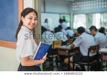 Beautiful secondary school girl in uniform smiles Stock photo © darrinhenry
